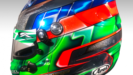Ryan Yop helmet featuring a chrome base with blue, green and orange colors.